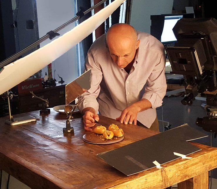 London food photographer Michael Michaels, making final adjustments before shooting