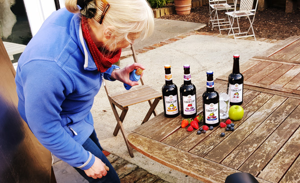 Food stylist Trish setting up bottles and fruit ready for first test shot for london food and drink photography
